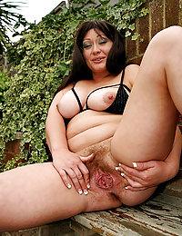 Huge dildo stuffed deep into busty mama's snatch
