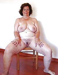Fat ravenhead grandma uncovers her yummy wet pussy