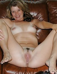 Well-shaped mature gal pulling down a bit her silky pantyhose for wild sex