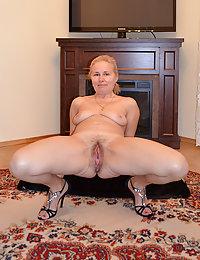 Blond boy sticks his cock up chubby mama's butt