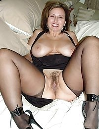 Skinny Redhead Milf With Fake Tits Spreads Her Cunt Wide Enough To See The Inside