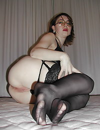 Sultry mom in shiny pantyhose warming up her pussy while blowing hard dick