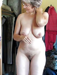 Mature chubby playing with tits and dildo